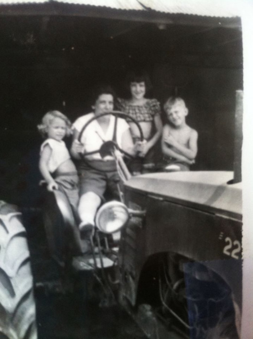 Four-year old me, sharing a tractor ride with my cousins from Ohio.