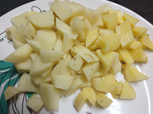 Peel and cube potatoes.