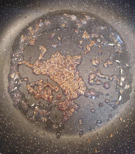 In a pan heat oil. Add mustard and cumin seeds. Let it splutter.