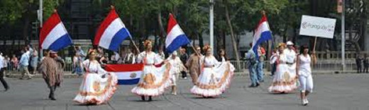 People of Paraguay in traditional wear in a procession