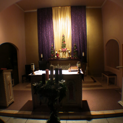 Advent wreath in front of altar in St. Ann's Catholic Church in Tubac, AZ