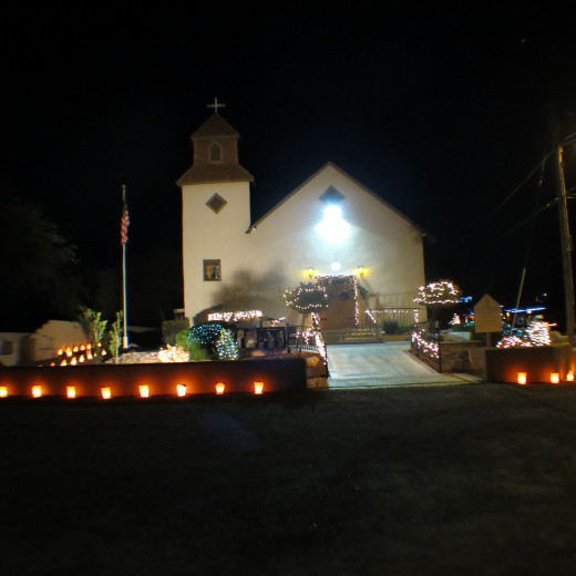 St. Ann's Catholic Church in Tubac, AZ  with luminarias and Christmas Decorations