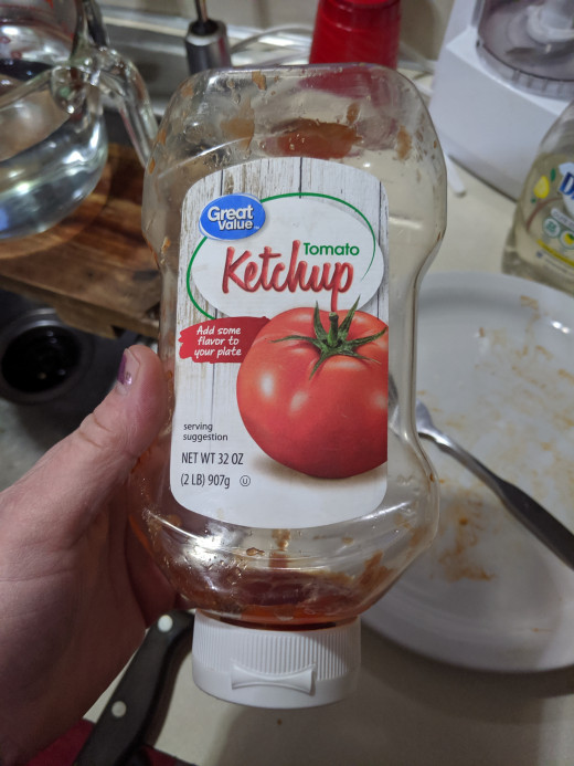 Using up last drops of ketchup in bottle
