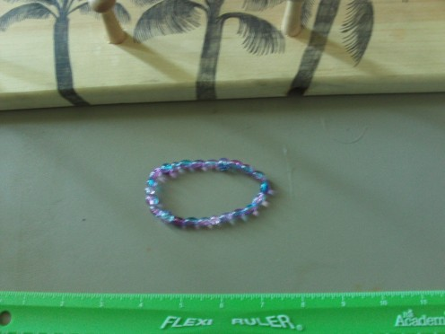 Tie the ends of the bracelet together.