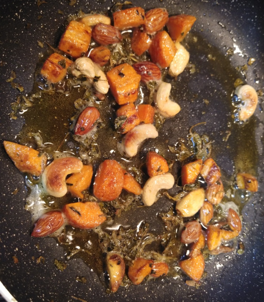 Fry in medium flame for 2-3 minutes or till nuts begins to brown.