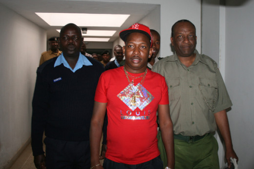 Mr. Mike Sonko being escorted along the court corridors.