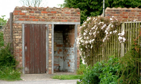 Although this outhouse is built of bricks, it is still considered an outhouse.