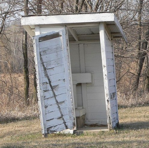 Even rough treatment cannot destroy the outhouse.