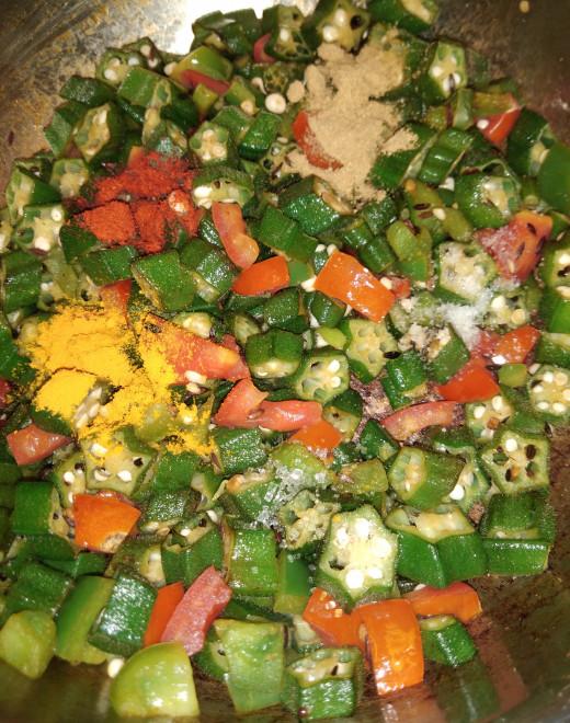 To this add turemric powder, red chili powder, coriander powder, salt and sugar.