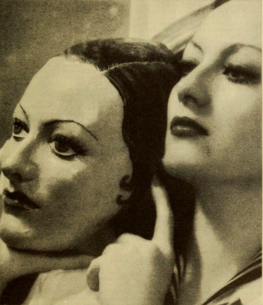Joan Crawford holding a face cast of herself.