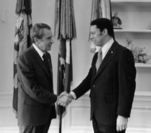 President Nixon shakes hands individually with White House Fellow Colin Powell.