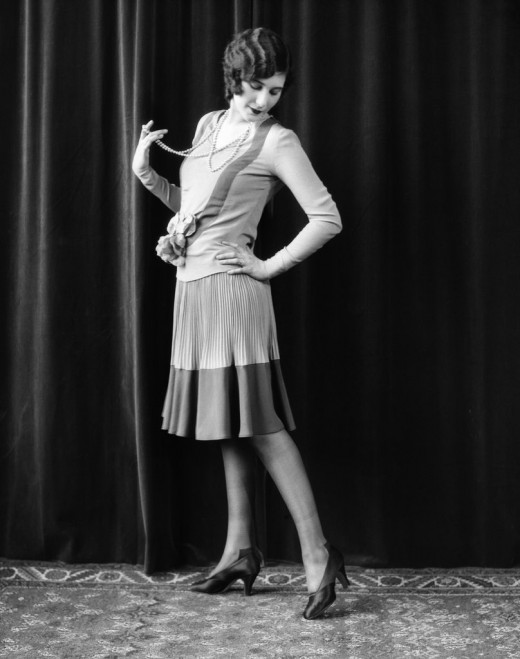 The flapper, one of the most famous images of the Roaring 20s, but not as dramatic as might be assumed in comparison to 19th century Victorian morality