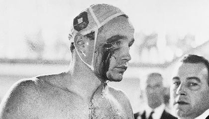 Ervin Zador of the Hungarian water polo team emerges from the pool at the 1956 Olympics with a bloodied face after being punched by his Soviet counterpart, Valentin Prokopov. With profound political overtones, the Hungarians won the semi-final match.