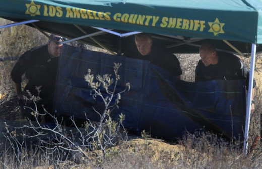 On September 4, 2013, while searching for Bryce Laspisa in the Castaic Lake area, Los Angeles County Sheriff's Department discovers a burning body. Photo courtesy of the Los Angeles Times.