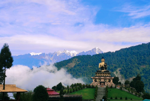 The enchanting view of Buddha Park with snow-clad mountains in the backdrop