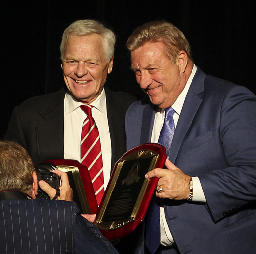Former St. Louis Cardinals running back, Jim Otis (right), is inducted into the St. Louis Sports Hall of Fame during a ceremony in 2005.