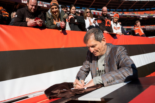 Former Cleveland Browns quarterback, Bernie Kosar, signs an autograph before a 2019 game against the Baltimore Ravens. After making a huge trade to draft Kosar in 1985, the Browns had no choice but to get the pick right. And they did.