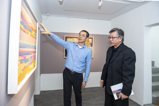Mr. Wu is guiding during the opening reception.
