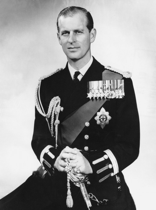 Prince Phillip looks like a carbon copy of Prince William and Prince Harry, looks like a smaller version of William.