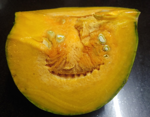 Wash yellow pumpkin to get rid of dirt if any.
