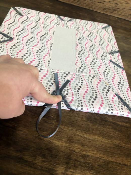 Center ribbon to be stapled.