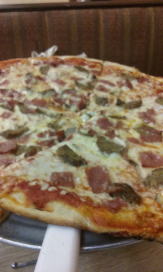 Delicious and piping hot pizza presented at our table at Homeslice Pizza Restaurant