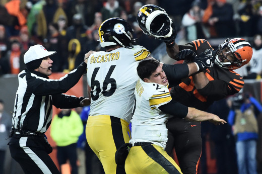 Cleveland Browns defensive end, Myles Garrett, hits Pittsburgh quarterback, Mason Rudolph (2), with his own helmet as David DeCastro (66) intervenes in a 2019 game. Garrett has tremendous talent but concerns about his demeanor are still unanswered.