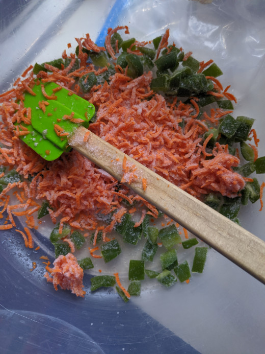 Add carrots and pepper to kimchee mixture