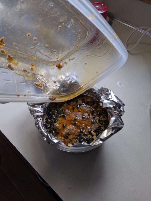 Pour grease into bowl, completely