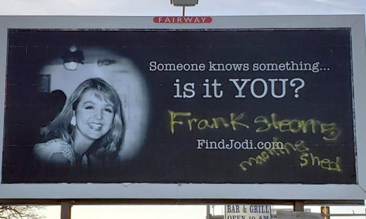 """Vandals deface a billboard of missing anchorwoman Jodi Huisentruit with the words """"Frank Stearns Machine Shed"""" in Mason City, Iowa."""