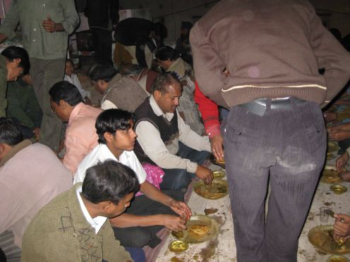 Paush Bada: Getting Prasad (Devoted meal)sitting in the floor out side Vardhaman Gems