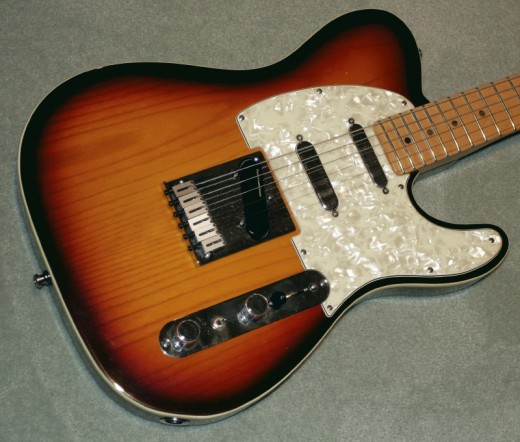 In the 90's, a lot of experimental Teles were produced, looking for a heavier sound than what the 50's and 60's models could deliver. This is the same layout of the currently popular Blackout Tele which features two neck pickups - one in the neck and