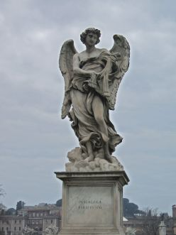 "Angel with the Whips on the bridge in front of Castel Sant'Angelo. The inscription from the Bible reads: ""I am ready for the whip""."