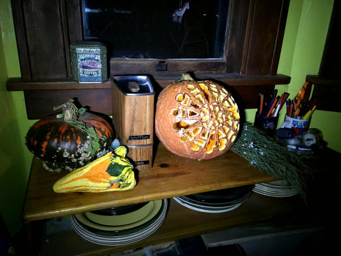 To the left is a Turks Turban squash or edible gourd, and a non-edible gourd with curlicues. I also tried my hand at fancy pumpkin carving--but found I had picked a fruit with an exceptionally hard rind!