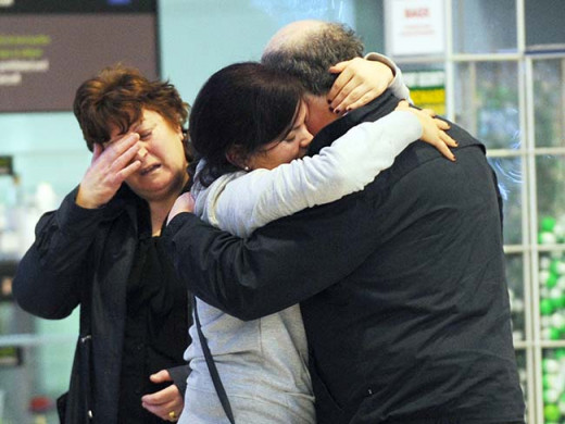 A family saying tearful goodbyes at Dublin airport