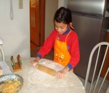 My daughter was forming a pizza dough.
