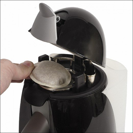 Inserting the pod into a Russell Hobbs Uno Pod Coffee & Tea Maker