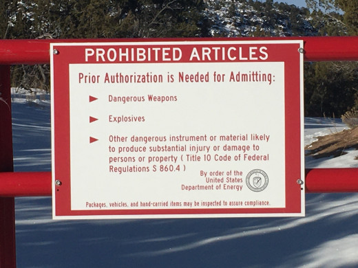 Prohibited Articles warning sign at the perimeter fence of the National Laboratories in Los Alamos, New Mexico.  You will see numerous signs like these on your way to Bandelier.