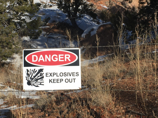 Explosives warning sign at the perimeter fence of the National Laboratories in Los Alamos, New Mexico.  You will see numerous signs like these on your way to Bandelier.