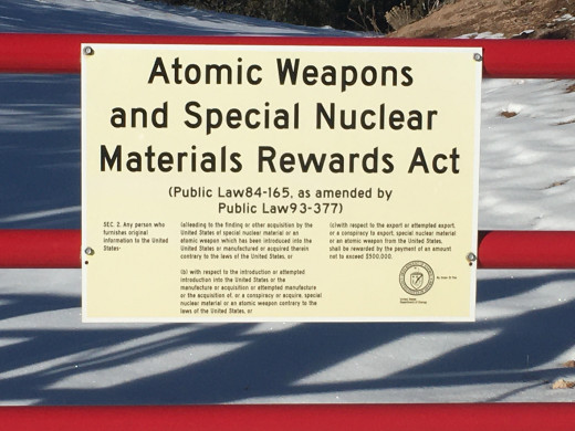 Warning signs (atomic weapons and nuclear materials) at the perimeter fence of the National Laboratories in Los Alamos, New Mexico.  You will see numerous signs like these on your way to Bandelier.