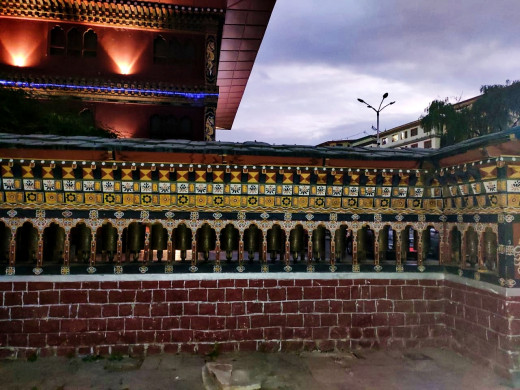 Stationary prayer wheels in a row