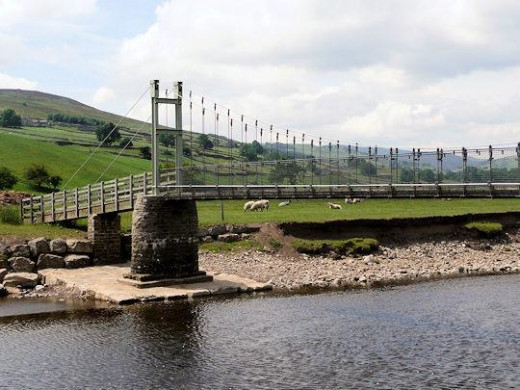 The suspension bridge across the Swale, washed away asnd replaced in the original style - seen from the riverside path