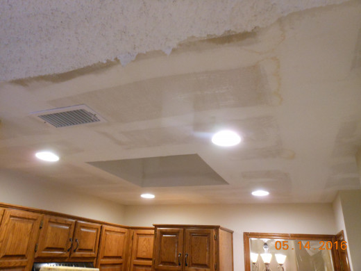 Ceiling water damaged and texture scraped off in order to repair and ready re-blow new texture after it dried out