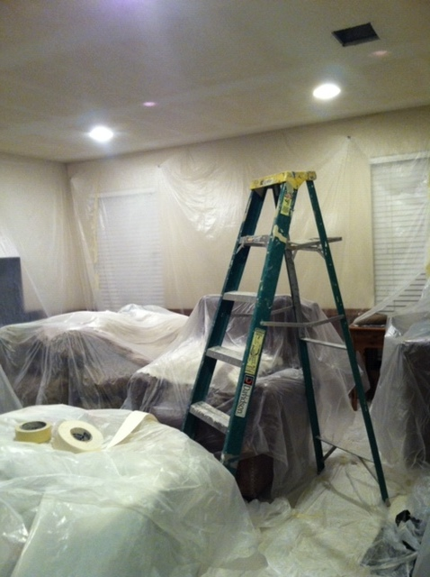 Furniture covered and drywall repairs being made. My wife and I did all of the repairs ourselve