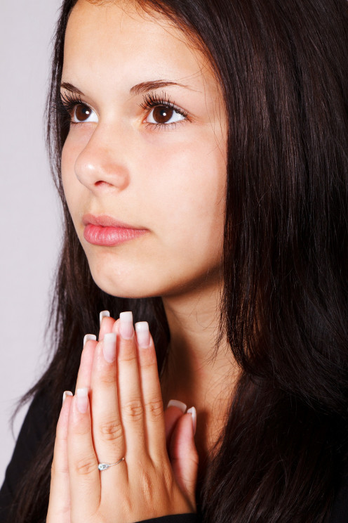 This girl is praying fro something and the photo symbolizes part of the band's name.