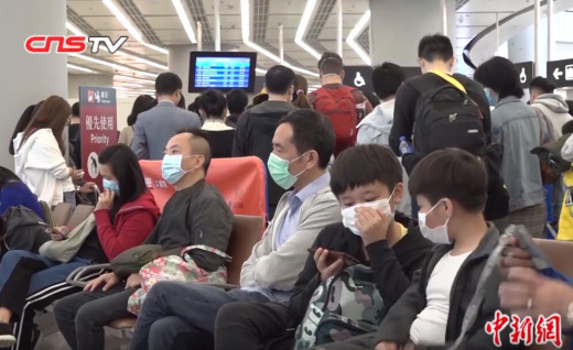 Travelers wearing face masks in Hong Kong West Kowloon Station