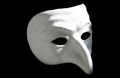 This mask symbolizes a part of the band's name because a phantom represents an evil kind of monster. Though this kind of mask is often used in theatrical plays as well.