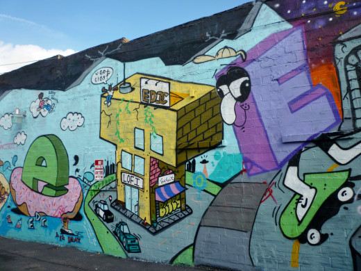 """Closeup of a mural on lo-fi store with the small letter """"e"""" and the large """"E"""" letter"""