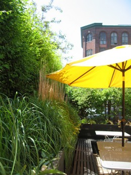 A simple look at a yellow market umbrella near a cozy spot.  Photo by http://www.flickr.com/photos/tsaiware/2657991789/