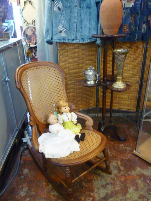 Rocking chair and dolls at AG Antiques on West 19th in the Houston Heights